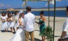 Beautiful beachfront wedding with Rev. Deb officiating.