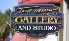 Tripp Harrison Gallery sign located in historic downtown St. Augustine.