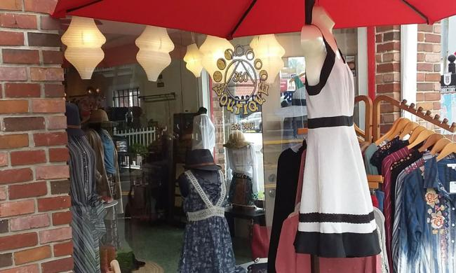 The front window with enticing fashions both outside and inside 360 Boutiqe in St. Augustine.
