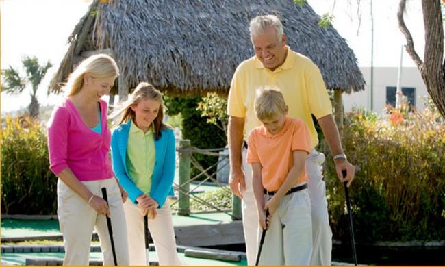Families love the miniature golf course at Adventure Landing.