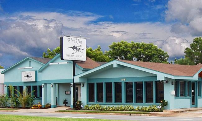 The Bahamian blue exterior of Blackfly the Restaurant in St. Augustine.