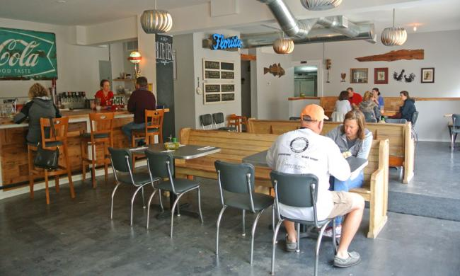 Patrons enjoying a meal inside Blue Hen Cafe in St. Augustine