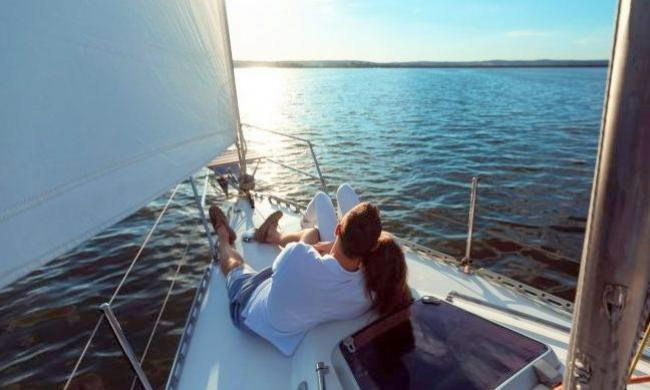 A couple enjoying a romantic sunset sail with St. Augustine Sailing in St. Augustine.