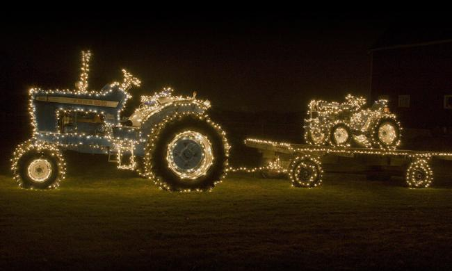 A tractor and trailer lit for the holidays at Elkton's Bright Nights of Drive-thru Lights in Elkton, just west of St. Augustine.