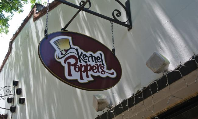 Enjoy a selection of over 250 flavors of popcorn at Kernel Poppers on St. George Street.