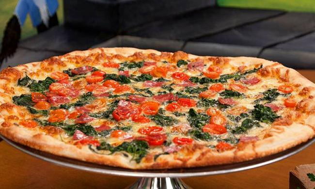 A crispy-crust pizza from Puccini's Pizzeria at Vilano Beach in St. Augustine.