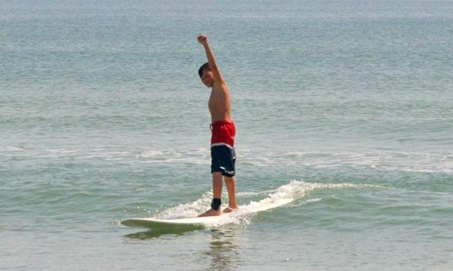 A young surfer learning at St. Augustine Surf School.
