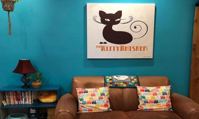 Sink into the comfy couch at The Witty Whiskers Cat Cafe in St. Augustine while you enjoy your coffee and feline friends