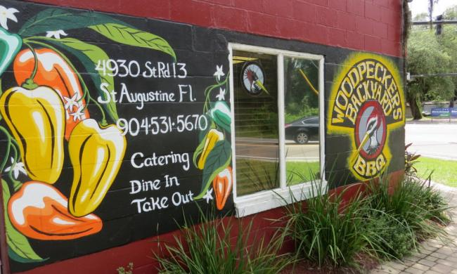 The bright exterior of Woodpecker's Backyard BBQ on route 13, west of St. Augustine.