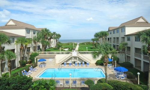Four Winds Condominiums features beach access and oceanfront views.