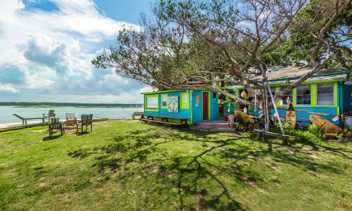 The lawn and waterfront at Genungs Fish Camp is available for private events.