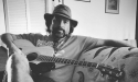 Jory Lyle sitting with his guitar