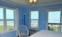 Bright bedrooms with ocean views at Saint Augustine Beach House