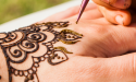 Henna art being done on a hand