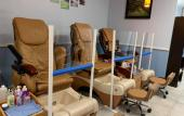 View of pedicure chairs inside of Best Nails