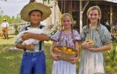 Children re-enacting life Florida during the last century, at the Florida Agricultural Museum.