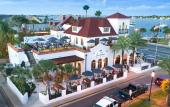 Casa Reina Taqueria & Taquila on the bayfront in St. Augustine is a regal white building with a red roof and outside dining spaces.