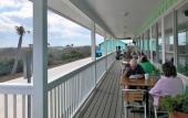 Dining on the deck with a view of the Matanzas at Commander's Shellfish Camp in St. Augustine.
