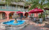 The Courtyard at the St. George Inn, featuring a fountain and seating area in St. Augustine.
