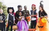 A group of friends and family enjoying the Halloween Bash in costume.