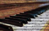 A photo of piano keys oveelaid with a music score.