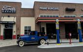 Ford's Garage, with antique gas pumps, garage doors, and Model-A Pick-up Truck in St. Augustine.