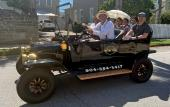 """A family of 5 enjoying a tour in a """"Model-T"""" with Pastime Tours in St. Augustine."""