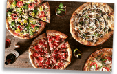 View of different pizzas offered by Mellow Mushroom