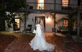 A bride taking photos in the Sanchez House courtyard