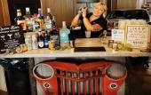 A bartender prepares a drink for Toast With Cocktails in St. Augustine, FL.